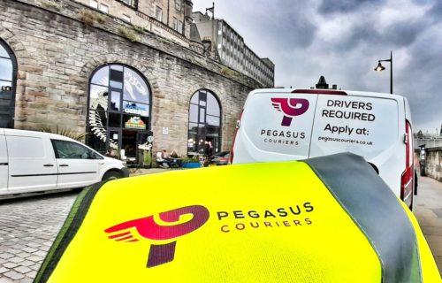 Pegasus Couriers van on the road